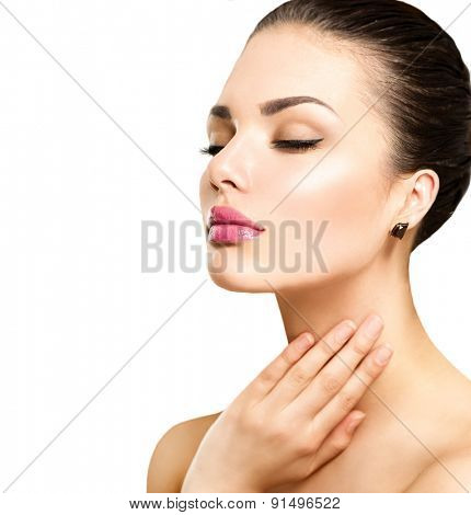 Beauty Portrait. Beautiful Spa Woman Touching her Face. Perfect Fresh Skin. Beauty brunette Model. Youth and Skin Care Concept. Studio shot
