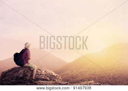 Young Backpacker Enjoying A Valley View