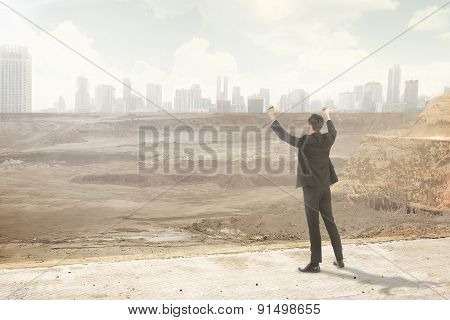 Asian Business Man Looking At The Destroyed City