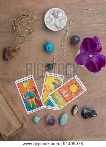 Tarot Cards And Stones Under Wooden Background