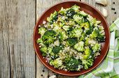 stock photo of quinoa  - roasted garlic broccoli quinoa salad on wood background  - JPG