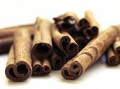 foto of cinnamon sticks  - Stack of cinnamon sticks against a white background - JPG