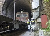 image of decontamination  - A team working with toxic acids and chemicals is saving people from a chemical cargo train crash near Sofia - JPG