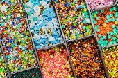 image of beads  - multicolored beads in a plastic box - JPG