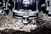 foto of towing  - Close up of new tractor hitch with tow bar and chains artistic effects rear view  - JPG