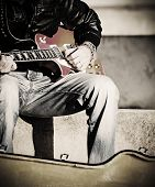 pic of guitarists  - close up of a guitarist playing in the street in vintage effect - JPG