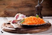 picture of korean  - Spicy Korean style carrot salad on metal plate with spices - JPG