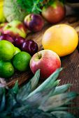 pic of exotic_food  - Fruit variety on wood. Tropical exotic food concept.