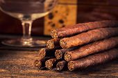 stock photo of cigar  - quality cigars for relaxing on an old wooden table - JPG