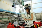image of icu  - Nurse with great medical backpack in ICU - JPG
