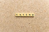 picture of extend  - extend word on the simple wooden background - JPG