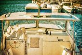 pic of outboard  - white boat in Alghero harbor - JPG