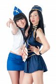stock photo of currency  - Two attractive woman in stewardess uniform - JPG