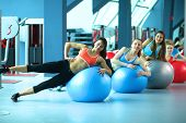 stock photo of pilates  - Group of people in a Pilates class at the gym  - JPG