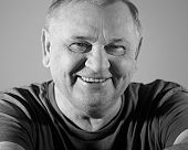 picture of retirement age  - Black and white portrait of cheerful aged man in t - JPG