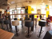 picture of angle  - Defocused and blurry image of the interior of a fast food restaurant with wide angle distortion view for use as a background - JPG