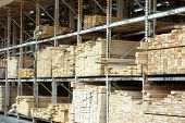 stock photo of 2x4  - lumber racks holding building materials and 2x4 - JPG