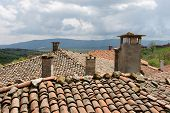 stock photo of chimney  - chimneys village houses in the mountains in Bulgaria in the spring - JPG