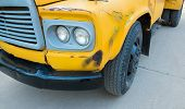 image of truck-stop  - front view of old truck with crack color - JPG