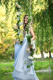 stock photo of seesaw  - bride on a seesaw - JPG