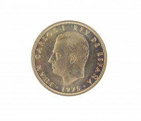 stock photo of spanish money  - Single old Spanish coins of 100 pesetas showing Juan Carlos I king - JPG