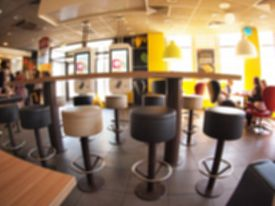 stock photo of distort  - Defocused and blurry image of the interior of a fast food restaurant with wide angle distortion view for use as a background - JPG