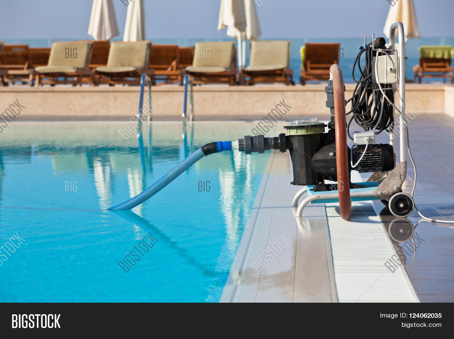 Cleaning Swimming Pool Pump : Cleaning pump working with a swimming pool horizontal