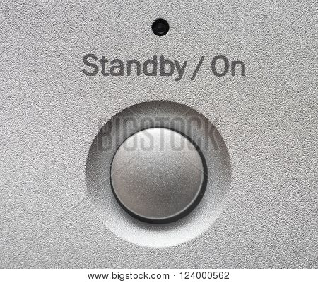 Aluminum button for a CD or DVD player.