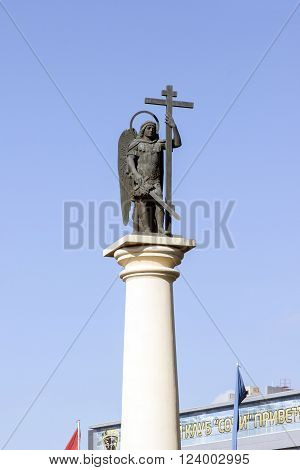 SOCHI RUSSIA - November 06 2015: A religious monument Saint Michael the Archangel with the weapon a sword in hands and a cross in an armor. Sochi Russia