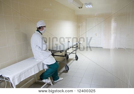 surgeon in the corridor to the operative room