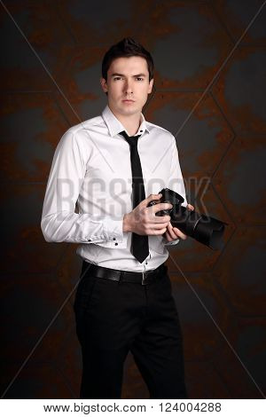 Professional photographer is waiting to make a shot