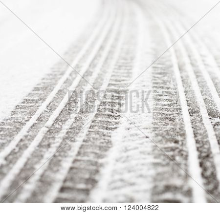 Wheel tracks on the winter road covered with snow. ** Note: Shallow depth of field
