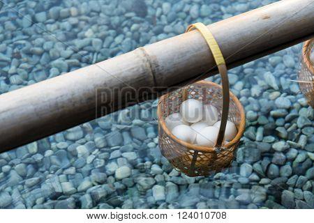 Japanese hot spring steam boil eggs dip basket in pond