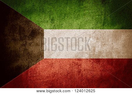 flag of Kuwait or Kuwaiti banner on rough pattern background