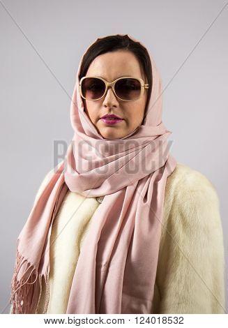 Portrait of glamor woman in headscarf at studio