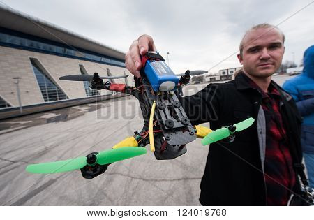 Saint-Petersburg, Russia - March 26, 2016: Flying drone assembled on their own. Trial starts drone to drone on racing competitions.