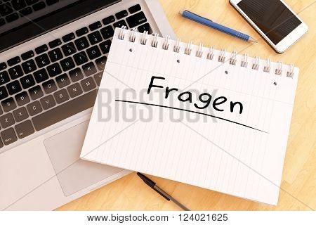 Fragen - german word for questions - handwritten text in a notebook on a desk - 3d render illustration.