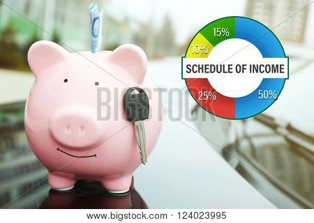 Business accounting concept. Piggy money box with cash and key on car bonnet at the street