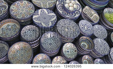 Decorated plates and traditional morocco souvenirs in medina souk