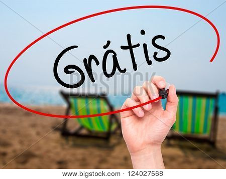 Man Hand Writing Gratis With Black Marker On Visual Screen.