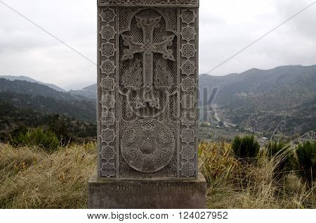 Stone cross monument the victims of  massacre Armenians on a hill in rural areas