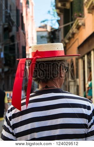 Gondolier With Red Ribbon Hat And Striped Jersey In Venice - Italy