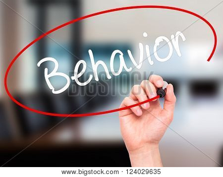 Man Hand Writing Behavior With Black Marker On Visual Screen.