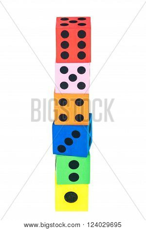Tower made of colorful foam dice isolated on white