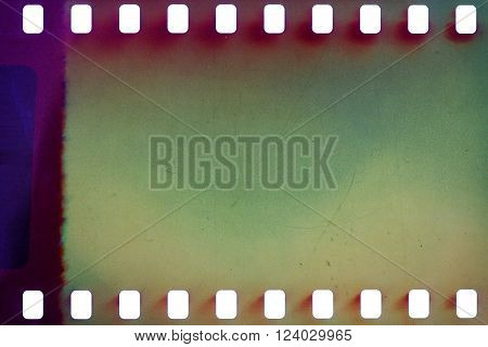Blank green vibrant noisy film strip texture background