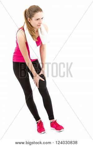 Fitness woman holding her injured knee. Isolated on white backgorund.
