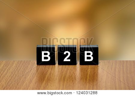 B2B or business to business on black block with blurred background