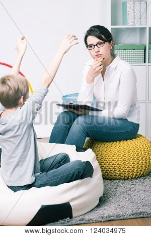 Concerned Young Psychologist And Small Patient