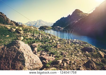 Landscape of beautiful Lake with Rocky Mountains Summer Travel serene view sunny day