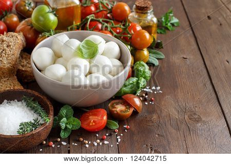 Italian food ingredients for caprese salad on wooden background